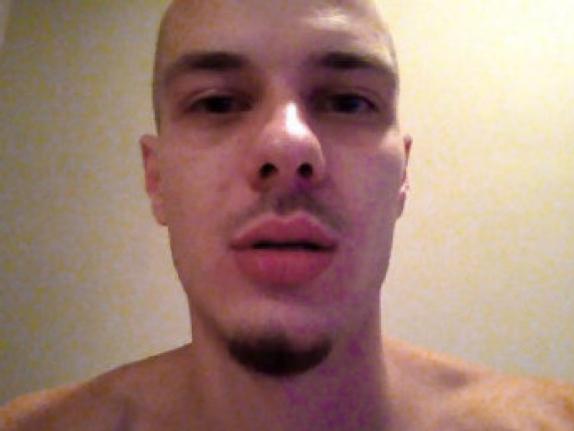 A selfie still from one of Mark Smich's rap videos